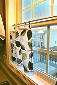 tension rod + shower curtain clips + towels or small fabric pieces + lovely kitchen window treatments!