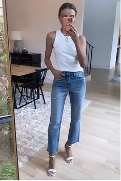 White tank with jeans and white sandal heels. I love that wide legged jeans are back, say goodbye to straight jeans.