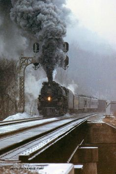 """During the ACE 3000 tests, Chesapeake & Ohio 4-8-4 """"Greenbrier"""" #614-T, owned by Ross Rowland, works hard moving a heavy coal drag at Handley, West Virginia on a snowy January 11, 1985. Photo by Jack Kuiphoff."""