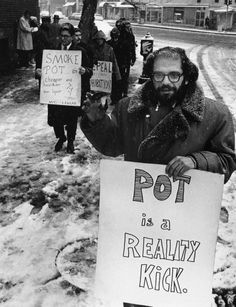 "Photographer unknown. Allen Ginsberg holding a sign that reads: ""Pot is a Reality Kick"". Maybe from Dec. 27, 1964. Large format retrieved from Imgur."