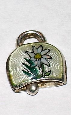 Sterling and white edelweiss cowbell charm