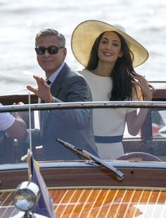 Year in celeb photos 2014: George Clooney and Amal Alamuddin head to the airport in Venice on Sept. 29, 2014.