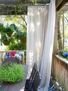 Drapery Panels - Smart Privacy Solutions for Outdoor Spaces on HGTV Maybe this would work on the back deck. . .