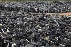 "yellow-yellow-data-mellow: "" Discarded television sets pile up in a scrap yard awaiting recycling in Zhuzhou city in south China's Hunan province. China's recycling industry has boomed over the past. Accurate World Map, Scrap Recycling, Department Of Veterans Affairs, Companies In Dubai, Dark Places, Photo Displays, Cemetery, City Photo, Environment"