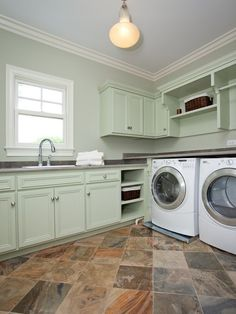 Design Ideas: Traditional Laundry Room With Green Cabinet. laundry room cabinet. light green cabinet. diagonal tile installing. pull down faucet. pendant light.
