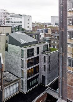 Architecture office DSDHA has completed an apartment block in London's Fitzrovia, which has a pair of faceted glass penthouses concealed behind its austere grey brick facades.