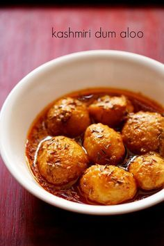 kashmiri dum aloo recipe - baby potatoes in a spicy vibrant curd based gravy. a recipe from the kashmiri cuisine.
