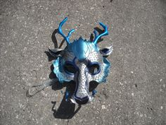 dragon mask, make the horns larger and extend the side frills