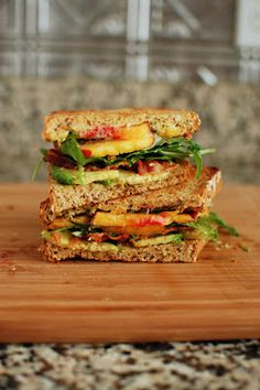 Peach, Bacon, Avocado Sandwich | Beantown Baker - For the Basil Sauce 1/4 cup packed basil 1 tsp lemon juice 3 Tbsp mayonnaise, homemade recommended Salt and pepper  For the Sandwiches 4 pieces multi-grain bread, toasted 6-8 slices bacon, cooked 1 ripe peach, sliced 1 avocado, sliced Arugula