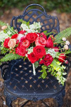 Red bridal bouquet with roses and ranunculus | Kendall Lynnette Photography & Design | see more on: http://burnettsboards.com/2014/06/disney-beauty-beast-wedding/