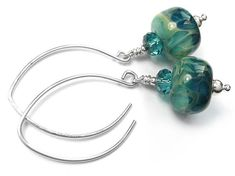 Gorgeous handmade earrings designed and made by Indigo Silver using lampwork boro glass beads with a gorgeous pattern and colour. These lovely beads have aqua green base with a blue pattern with depth. Swarovski Crystal Beads, Silver Beads, Glass Earrings, Glass Beads, Designer Earrings, Earrings Handmade, Sterling Silver Jewelry, Indigo, Aqua