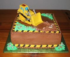 Bulldozer cake--I like the caution edging and grass with rocks in it