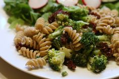 The Fresh and Green Table - cavatappi (or substitute corkscrew), broccoli, dried red tomatoes, garlic, goat cheese, parmesan cheese