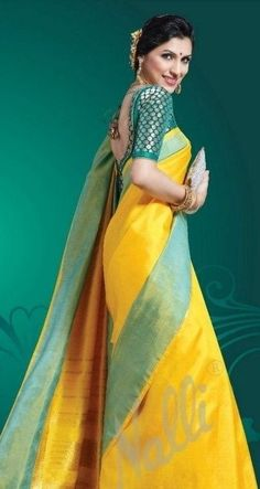 Plain yellow and green lets the beauty of the silk cloth shine through. A long sleeved blouse and a silver clutch complete this look of understated elegance. Saree Blouse Patterns, Saree Blouse Designs, Indian Attire, Indian Ethnic Wear, Indian Dresses, Indian Outfits, Modern Saree, Indian Silk Sarees, Kanchipuram Saree