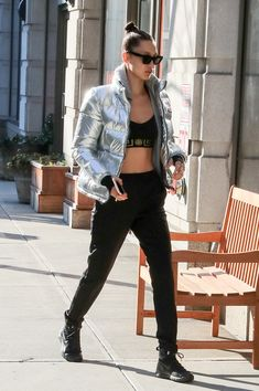 Bella Hadid stayed warm in her crop top with a metallic puffer jacket.              Image Source: Getty / I...