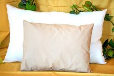 Mini Pillow by All Finer Things. The Mini Pillow has a Stone coloured Egyptian cotton pillow case. Buy Now online:- http://allfinerthings.wozaonline.co.za/
