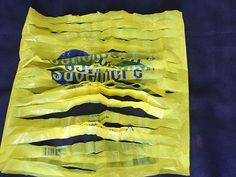"how to cut a plastic shopping bag into ""yarn"" for knitting or crochet projects. this could be cool for an outdoor patio rug! [ ""How to Prepare Plastic Bags for Knitting or Crochet. If you have decided to knit or crochet a bag from plastic bags, you Plastic Bag Crafts, Plastic Bag Crochet, Recycled Plastic Bags, Recycled Crafts, Plastic Plastic, Plastic Spoons, Recycled Clothing, Recycled Fashion, Recycled Materials"