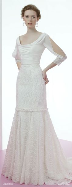 Mermaid Wedding Dresses : Short wedding dress in lace. This dress can be transformed into a mermaid cut wi