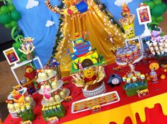 Cake table / candy buffet for a Winnie The Pooh themed 1st birthday party. Design & setup by ParteeBoo - The Party Designers!