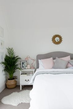 Blush, grey and white bedroom