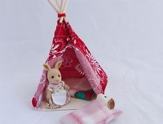 These bright tepees are great for many hours of fun playing camping with sylvanian family figurines and small dolls. Fabulous for Christmas gifts too. They are made from cotton/blend fabrics and the front opening is attached back with Velcro. They come with 2 polar fleece sleeping bags and the floor...