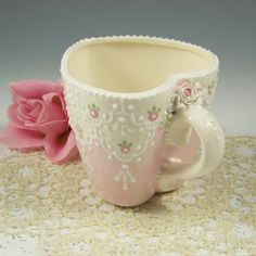 Lovely heart-shaped tea cup with lace look and dainty flowers, (AC)