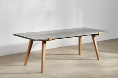 A solid oiled oak frame with traditional peg joint and a zinc wrapped top. The charm of zinc is that because it stains quite easily, each table has a story. Concrete Furniture, Furniture Design, Cement Table, Solid Oak Dining Table, Victorian Terrace House, Hardwood Table, Coffee Table Design, Ping Pong Table, Kitchen Tables