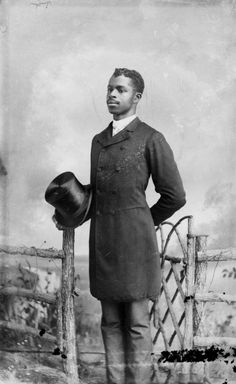 Florida Memory - Man holding a top hat, circa 1885-1910. Photograph from the Alvan S. Harper Collection at the State Archives of Florida.