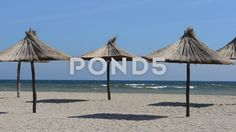 Video footage. Pond5.com. Straw umbrellas on the beach.    #sand #wave #water #beach #background #sea #scene #ocean #outdoor #island #coast #nobody #natural #tropical #travel #dream #peace #holiday #scenery #paradise #season #backdrop #blue #weather #relax #tourism #resort #nature #vacation #umbrella #straw #landscape #shore #wet #destination #enjoy #relaxing #tourist #shoreline #texture #seacoast #marine #seascape #beautiful #coastline #alone #relaxation #day #afternoon #summer  #Video…