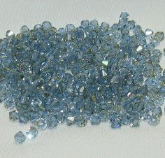 24 Swarovski Crystal 4mm light sapphire champagne #5301. Starting at $6 on Tophatter.com!