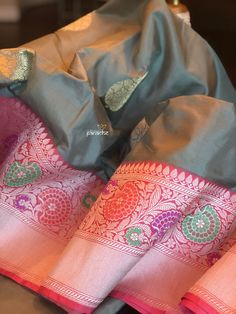 Code: Type: Pure Silk Katan BanarasiColor: Blue, PurpleDesign : Intricate Zari Benarasi Motifs all over, heavy Zari woven border along the skirt and Kadwa woven flowerBP: Yes, Running