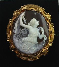 Material: Sardonyx Shell, 15k gold marked.      Size: 2 1/8 by 1 7/8, cameo itself is 1 5/8 by 1 3/8..      Date and Origin: Circa 1860 Italy.