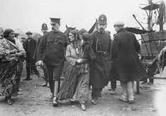 Police escorting Gypsy woman, c1911. (This is not Brough Hill Fair)  By courtesy of the University of Liverpool Library.(Gypsy Lore Society Collection)