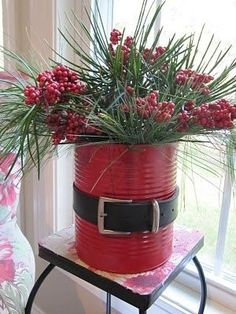 Spray paint a can and decorate with a belt like Santa - great to use as a christmas card holder or as pictured. #Artsandcrafts