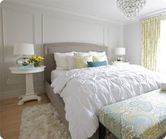 Love the blue, green accents and paneled walls in this beautiful master bedroom.