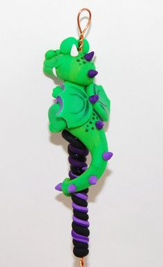 Green & Purple Dragon Spinning Wheel Orifice Hook by TheClaySheep