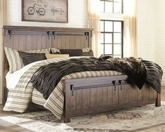 Opposites attract. The Lakeleigh panel bed opens our eyes to how casually rustic styling and an industrial hip vibe make for one happy marriage. Elements that beautify the chunky, linear profile include through-tenon styling, replicated planking and faux barn door hardware loaded with charm. What's even more surprising: how such a high-quality designer piece can be so attractively priced. Mattress and foundation/box spring available, sold separately. Farmhouse Master Bedroom, King Bedroom, Master Bedrooms, Industrial Bedroom Furniture, Farmhouse Furniture, Rustic Furniture, Ashleys Furniture, Farmhouse Decor, Cheap Furniture