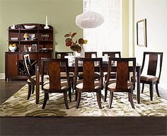 """Boulevard Dining - the """"flow"""" of dark and medium shades of brown somewhat mirror the shape of the animal print in the living room rug and sofa pillows - creating an elegant curve effect. The green accents """"lift"""" the room and add visual interest."""