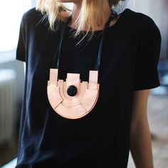 London designer Simone Brewster's Revolution Major necklace is the ultimate statement piece — a solid plate of geometrically cut copper with a strong architectural presence. Inspired by Art Nouveau and African woodwork - 305$