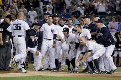 6/20/14 - BRONX: The New York Yankees await Carlos Beltran (36) as he approaches home plate after hitting a game-winning three-run home run against the Baltimore Orioles in the ninth inning of a baseball game, Friday, June 20, 2014, in New York. The Yankees won 5-3. (AP Photo/Julie Jacobson)