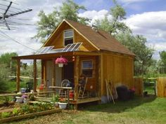 This shed/cabin was built from all new materials (except windows and doors which were recycled) for under $2000.    It is 14x14 with a full loft and approximately 400 sqft of space.    Downstairs is kitchen, full bathroom, dining and living area. Upstairs loft is bedroom, office and storage space.    I live in this cabin full time but it could be used for a great workshop shed, of...