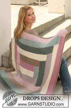 """Free pattern: Knitted DROPS blanket with stripes in """"Nepal""""."""