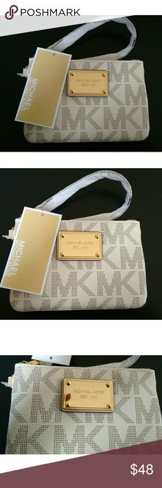 New! Authentic MICHAEL KORS MK Logo Wristlet NWT Authentic MICHAEL Michael Kors MK Signature Logo Wristlet   Brand New With Tags  Color: Vanilla   Gold-tone logo plaque at front MK Monogram print exterior  Wristlet with strap Top zip closure  Interior has 3 slip pockets Measurement: 6 inch Width, 4 inch Height, 1 inch Depth Material: MK Signature PVC  *** PRICE IS FIRM *** ***NO TRADES *** Michael Kors Bags Clutches & Wristlets