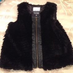 Kensie Black fur vest Black faux fur vest. Leather in the middle with gold zipper.  Worn once it's in great condition. Kensie Jackets & Coats Vests