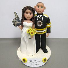 Boston Bruins fans custom wedding cake topper handmade using polymer clay. clayinaround.etsy.com