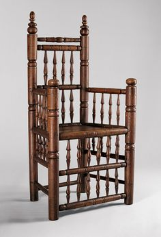 Spindle–back armchair, 1640–80 Boston or Charlestown, Massachusetts Ash 44 3/4 x 23 1/2 x 15 3/4 in. (113.7 x 59.7 x 40 cm) This armchair is the product of the turner's craft—every element, save the plank seat, was shaped with chisels and gouges while it spun, or turned, on a lathe. The tiers of tapered spindles in the front, sides, and back create a virtual screen around the sitter and help temper the massive proportions of the front and back posts.]