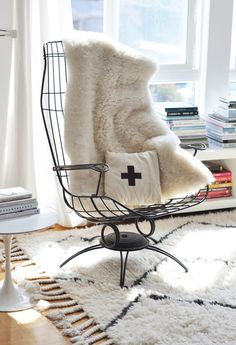 I love the room the chair, the side table, the rug the pillow the throw..look at the fringe on the rug Can I go there and sit?