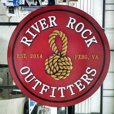 River Rock Outfitters- Double sided HDU Sign - Hand carved and and painted details, side-mount custom Bracket. We are very pleased with these and can't wait to see them installed on the building! — at Art and Sign F/X, Inc.