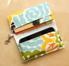 @Kristen Campos...you need to add this to your sewn items!!!   iPhone Wallet  Cell Phone Wallet