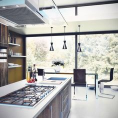 I love the cabinets in this kitchen space. I've never seen cabinets that were stained this way! I love that it's more of an ashy color, which allows it to match with the cooler tones and more modern theme of the rest of the room.